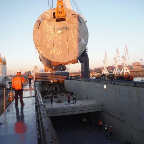 Loading tower sections by Siemens